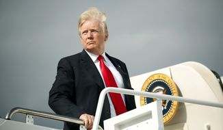 President Donald Trump boards Air Force One during his departure from Andrews Air Force One Base, Md., Saturday, April 28, 2018. Trump is traveling to Michigan to speak at a rally on the same night as the White House Correspondent's Dinner, the second straight year Trump has skipped the event with the White House Press Corps. (AP Photo/Pablo Martinez Monsivais)