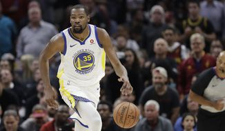 Golden State Warriors' Kevin Durant dribbles in the first half of Game 3 of basketball's NBA Finals against the Cleveland Cavaliers, Wednesday, June 6, 2018, in Cleveland. (AP Photo/Tony Dejak)