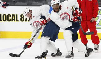 Washington Capitals' Devante Smith-Pelly (25) battles with Jay Beagle, left, during a face off during an NHL hockey practice Wednesday, June 6, 2018, in Las Vegas. The Capitals lead the Vegas Golden Knights 3-1 in the best-of-seven Stanley Cup Finals series. (AP Photo/Ross D. Franklin) ** FILE **