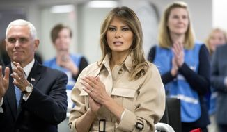 First lady Melania Trump, center, accompanied by Vice President Mike Pence, left, applauds as President Donald Trump speaks to employees at the Federal Emergency Management Agency Headquarters, Wednesday, June 6, 2018, in Washington. (AP Photo/Andrew Harnik)