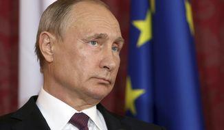 Russian President Vladimir Putin attends a joint press conference with Austrian President Alexander Van Der Bellen as part of a meeting in Vienna, Austria, Tuesday, June 5, 2018. (AP Photo/Ronald Zak)
