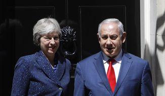 Britain's Prime Minister Theresa May greets Israeli Prime Minister Benjamin Netanyahu in Downing Street, London, Wednesday, June 6, 2018. May and Netanyahu held talks inside 10 Downing Street. (AP Photo/Alastair Grant)