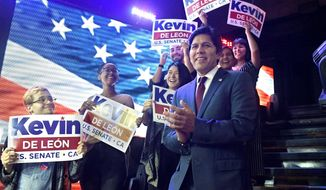 Kevin de Leon, California state Senate president pro tem and Democratic candidate for the U.S. Senate, takes the stage before speaking during an election party Tuesday, June 5, 2018, in Los Angeles. (AP Photo/Mark J. Terrill)