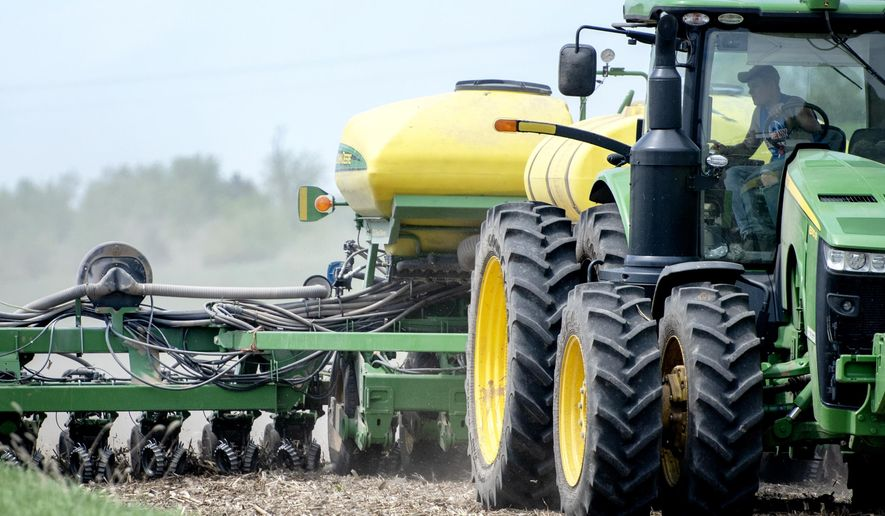 A farmer plants soybeans Friday, May 18, 2018, in an untilled field near Albany, Wis. No-till planting helps fields retain moisture and resist erosion.  (Angela Major/The Janesville Gazette via AP)