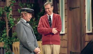"This image released by Focus Features shows David Newell, as Mr. McFeely, left, and Fred Rogers on the set of ""Mister Rogers' Neighborhood,"" from the film, ""Won't You Be My Neighbor."" (Lynn Johnson/Focus Features via AP)"