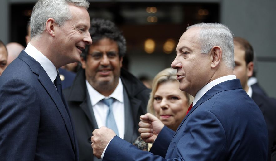 French Finance Minister Bruno Le Maire accompanies Israel's Prime Minister Benjamin Netanyahu after their meeting at Bercy Economy Ministry, in Paris, Wednesday, June 6, 2018. Netanyahu met French Finance Minister Bruno Le Maire, who is pushing to maintain European trade with Iran allowed under the 2015 deal curbing Iranian nuclear activities.(AP Photo/Francois Mori)