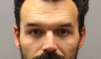 This undated photo provided by Metro Nashville Police Department shows Domenic Micheli, who authorities say attacked and killed his former boss, Joel Paavola, early Monday, June 4, 2018, with a hatchet and another bladed instrument at The Balance Training center in the Nashville area. (Metro Nashville Police Department via AP)