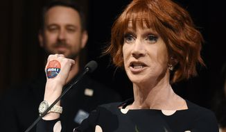 "Comedian Kathy Griffin shows off her ""I Voted"" sticker as she accepts a Rainbow Key Award from the City of West Hollywood, Tuesday, June 5, 2018, in West Hollywood, Calif. Griffin was recognized for her longtime support of the lesbian, gay, bisexual and transgender community. A California primary election was held Tuesday. (Photo by Chris Pizzello/Invision/AP) ** FILE **"