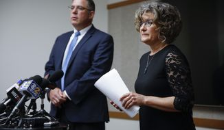 State House employee Sherri Garrett speaks in detail of her experience with sexual harassment in the workplace as attorney Ed Mullen listens in Chicago on Wednesday, June 6, 2018.  (Jose M. Osorio/Chicago Tribune via AP)