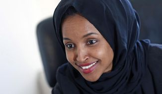 FILE - In this Jan. 5, 2017, file photo, new State Rep. Ilhan Omar is interviewed in her office two days after the 2017 Legislature convened in St. Paul, Minn. Omar, already the first Somali-American to be elected to a state legislature, is jumping into a crowded race for a Minnesota congressional seat. Omar filed Tuesday, June 5, 2018, for the Minneapolis-area seat being vacated by U.S. Rep. Keith Ellison. (AP Photo/Jim Mone, File)
