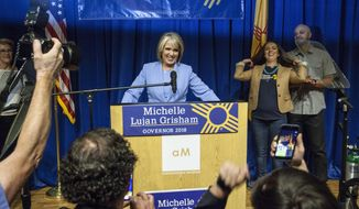 U.S. Rep. Michelle Lujan Grisham speaks to supporters in Albuquerque, M.M., Tuesday, June 5, 2018. Grisham won the Democratic nomination for governor. (AP Photo/Juan Labreche)