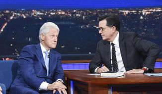 "In this image released by CBS, former President Bill Clinton, left, appears with host Stephen Colbert while promoting his book ""The President is Missing,"" on ""The Late Show with Stephen Colbert,"" Tuesday, June 5, 2018 in New York. (Scott Kowalchyk/CBS via AP)"