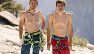 In this June 3, 2018 photo provided by Corey Rich, Alex Honnold, right, and Tommy Caldwell pose for a portrait at the top of El Capitan in Yosemite National Park, Calif. Days after two of the world's most celebrated rock climbers twice set astonishingly fast records on the biggest wall in Yosemite National Park, they did it again Wednesday, June 6, 2018, breaking a mark compared with track's four-minute mile. (Corey Rich/Reel Rock /Novus Select via AP)