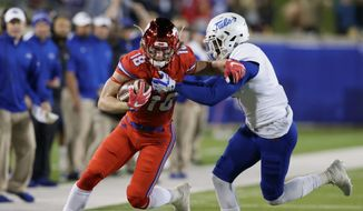 "Wide receiver Trey Quinn (18), who led the NCAA in receptions last season with SMU, was selected by the Washington Redskins with the 256th pick in the 2018 NFL Draft. As the last pick of the draft, Quinn was given the yearly moniker, ""Mr. Irrelevant."" (ASSOCIATED PRESS)"