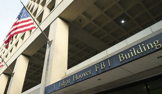 The FBI's J. Edgar Hoover Headquarters, across the street from the Justice Department in Washington, Wednesday, Nov. 2, 2016. (AP Photo/Cliff Owen)