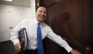 House Ways and Means Committee Chairman Kevin Brady, R-Texas, arrives for a closed-door GOP meeting in the basement of the Capitol as the Republican leadership tries to reach a policy agreement between conservatives and moderates on immigration, in Washington, Thursday, June 7, 2018. (AP Photo/J. Scott Applewhite) **FILE**