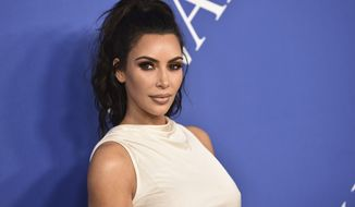 FILE - In this June 4, 2018 file photo, Kim Kardashian West arrives at the CFDA Fashion Awards at the Brooklyn Museum in New York. The reality star successfully appealed to President Donald Trump to release Alice Marie Johnson from prison. Johnson, who spent more than two decades in federal prison on 1996 drug convictions and was not eligible for parole, had her sentence commuted this week. (Photo by Evan Agostini/Invision/AP, File)
