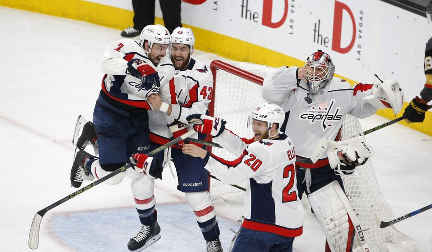 8556b5b2c Members of the Washington Capitals celebrate as they defeat the Vegas  Golden Knights in Game 5