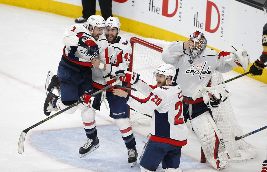 Members of the Washington Capitals celebrate as they defeat the Vegas Golden Knights in Game 5 of the NHL hockey Stanley Cup Finals to win the Stanley Cup Thursday, June 7, 2018, in Las Vegas. (AP Photo/Ross D. Franklin)