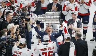 Washington Capitals team owner Ted Leonsis hoists the Stanley Cup after after the Capitals defeated the Golden Knights 4-3 in Game 5 of the NHL hockey Stanley Cup Finals Thursday, June 7, 2018, in Las Vegas. (AP Photo/Ross D. Franklin)