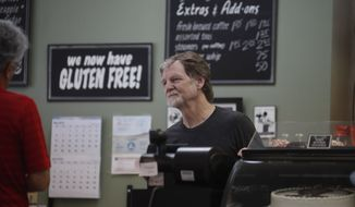 Baker Jack Phillips, owner of Masterpiece Cakeshop, manages his shop after the U.S. Supreme Court ruled that he could refuse to make a wedding cake for a same-sex couple because of his religious beliefs did not violate Colorado's anti-discrimination law Monday, June 4, 2018, in Lakewood, Colo. (AP Photo/David Zalubowski)
