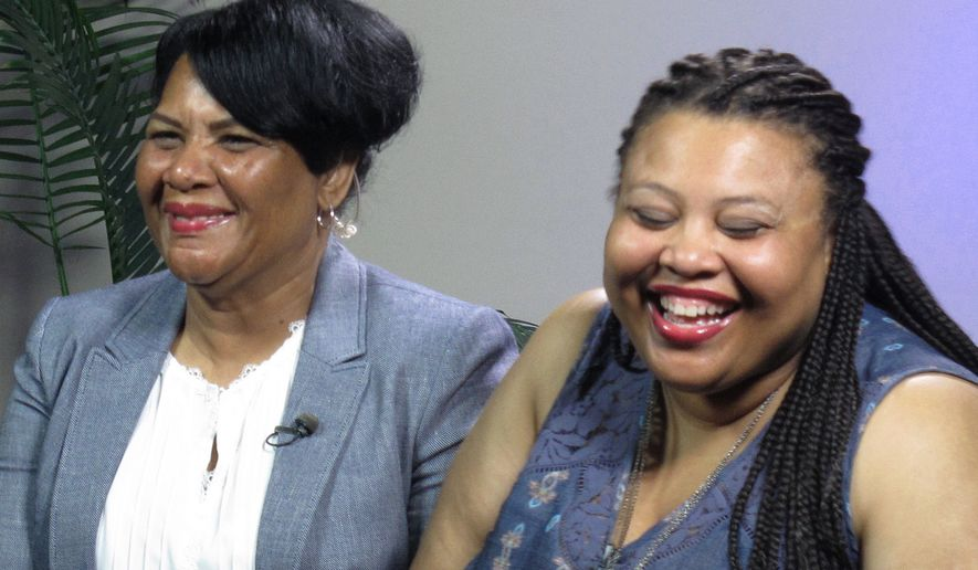 "Alice Marie Johnson, left, and her daughter Katina Marie Scales wait to start a TV interview on Thursday, June 7, 2018 in Memphis, Tenn. Johnson, 63, whose life sentence was commuted by President Donald Trump thanked him on Thursday for ""having mercy"" and said reality TV star Kim Kardashian West saved her life.  (AP Photo/Adrian Sainz)."