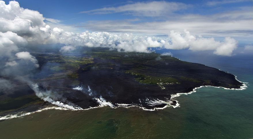 Most of the Kapoho area including the tide pools is now covered in fresh lava with few properties still intact as the Kilauea Volcano lower east rift zone eruption continues on Wednesday, June 6, 2018, in Pahoa, Hawaii. (AP Photo/LE Baskow)