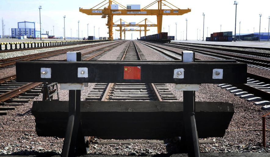 In this April 2, 2018 file photo, a Chinese flag is seen on the end of a railway track at the Khorgos Gateway, one of the world's largest dry dock in a remote crossing along Kazakhstan's border with China near Khorgos. (AP Photo/Ng Han Guan) **FILE**