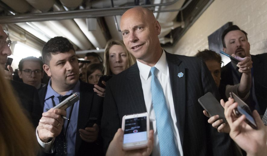 Reporters pursue Marc Short, the White House legislative liaison, as House Republicans try to bridge their party's internal struggle over immigration at a closed-door meeting on Capitol Hill in Washington, Thursday, June 7, 2018. Top Republicans want to head off an election-year showdown that divides the party. (AP Photo/J. Scott Applewhite)