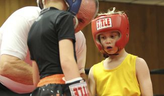 """In this May 19, 2018 photo Rocky Seibel, right, of the Belleville Boxing Club faces his opponent  during the """"Showdown at the Moose"""" event at Lodge 1221 in Swansea Ill. He was born just 10 years ago, but Rocky Seibel insists he's spent every second since wanting to be a boxer. Then again, with a name like Rocky, it might have been preordained. The Swansea fifth-grader is, indeed, named after the fictional Philadelphia fighter portrayed in film by Sylvester Stallone. And, wouldn't you know it, Seibel is a southpaw, too. (Todd Eschman/Belleville News-Democrat, via AP)"""