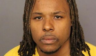 FILE - This file booking image provided by the Denver Police Department shows Michael Andre Hancock, who was arrested Friday, June 1, 2018, in connection with the fatal shooting of a passenger on Interstate 25. Hancock was charged on Thursday, June 7, 2018 with first degree murder in the shooting. (Denver Police Department via AP, File)