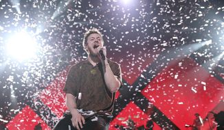 FILE - In this Feb. 1, 2018 file photo, Dan Reynolds, lead singer of Imagine Dragons, performs at the EA Sports Bowl in Minneapolis. The band kicked off the second leg of its Evolve World Tour this week. (Photo by Omar Vega/Invision/AP) ** FILE **