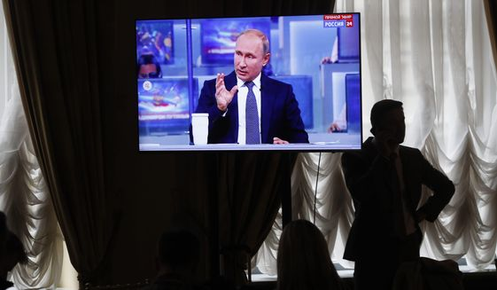 Russian President Vladimir Putin has turned the dissemination of false news into a worldwide tool of influence. (Associated Press/File)