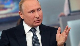 Russian President Vladimir Putin gestures while answering a question during his annual call-in show in Moscow, Russia, Thursday, June 7, 2018. Putin hosts call-in shows every year, which typically provide a platform for ordinary Russians to appeal to the president on issues ranging from foreign policy to housing and utilities. (Mikhail Klimentyev, Sputnik, Kremlin Pool Photo via AP)