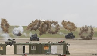 Military tanks take part in the annual Han Kuang exercises at an air base in Taichung County, Taiwan, Thursday, June 7, 2018.(AP Photo/Chiang Ying-ying)