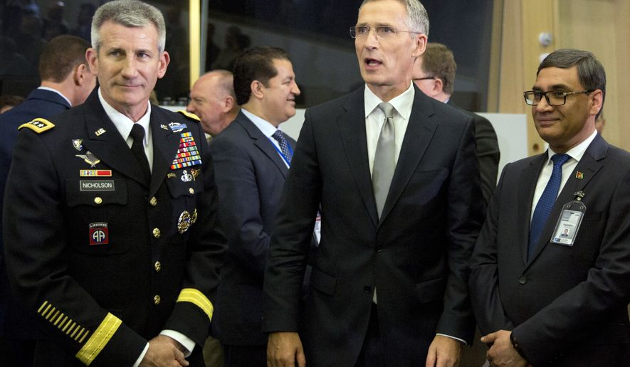 NATO Secretary General Jens Stoltenberg, center, speaks with the top commander of U.S. forces in Afghanistan General John Nicholson, left, and Afghanistan's Defense Minister Tariq Shah Bahrami, right, during a round table meeting of the North Atlantic Council with Resolute Support Operational Partner Nations at NATO headquarters in Brussels, Friday, June 8, 2018. (AP Photo/Virginia Mayo)