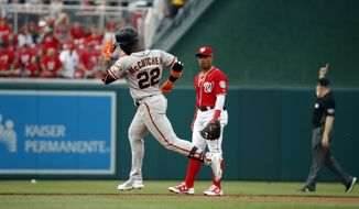 San Francisco Giants' Andrew McCutchen (22) rounds the bases after his solo home run as Washington Nationals second baseman Wilmer Difo watches during the first inning of a baseball game at Nationals Park, Friday, June 8, 2018, in Washington. (AP Photo/Alex Brandon)