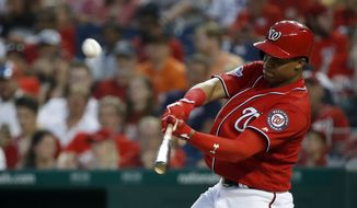 Washington Nationals' Juan Soto hits a two-run home run during the fourth inning of a baseball game against the San Francisco Giants at Nationals Park, Friday, June 8, 2018, in Washington. (AP Photo/Alex Brandon) **FILE**