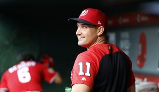 Washington Nationals first baseman Ryan Zimmerman (11) smiles in the dugout before a baseball game against the San Francisco Giants at Nationals Park, Friday, June 8, 2018, in Washington. (AP Photo/Alex Brandon) ** FILE **