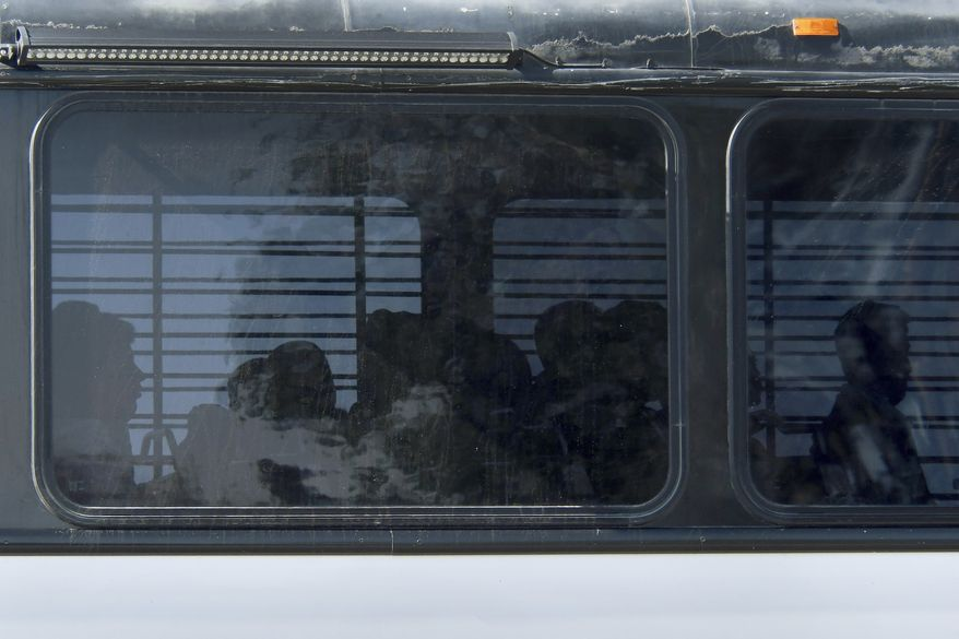 Homeland Security buses enter the Federal Correctional facility in Victorville, Calif., on Friday, June 8, 2018. More than 1,600 people arrested at the U.S.-Mexico border, including parents who have been separated from their children, are being transferred to federal prisons, U.S. immigration authorities confirmed Thursday. They said they're running out of room at their own facilities amid President Donald Trump's crackdown on illegal immigration. There are 1,000 beds available in this prison. (James Quigg/The Daily Press via AP)