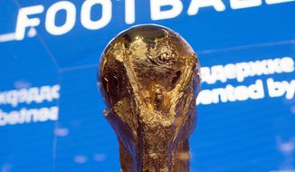 The World Cup trophy is on display at the FIFA museum in Moscow. The 21st World Cup begins Thursday when host Russia takes on Saudi Arabia. (Associated Press)