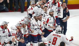 Washington Capitals' Alex Ovechkin (8) celebrates with teammates after the Capitals defeated the Vegas Golden Knights in Game 5 of the NHL hockey Stanley Cup Finals Thursday, June 7, 2018, in Las Vegas. (AP Photo/Ross D. Franklin)
