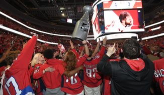 Washington Capitals fans celebrate at a viewing party in Washington after Game 5 of the NHL hockey Stanley Cup Final between the Capitals and the Vegas Golden Knights in Las Vegas, Thursday, June 7, 2018. The Capitals won the Stanley Cup. (AP Photo/Nick Wass) **FILE**