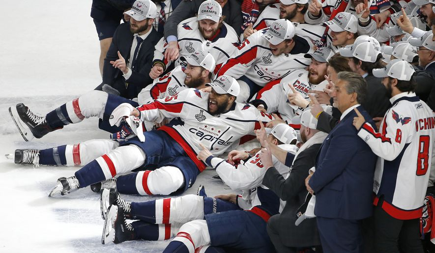 The Washington Capitals pose for a team photograph on the ice after the Capitals defeated the Vegas Golden Knights in Game 5 of the NHL hockey Stanley Cup Finals Thursday, June 7, 2018, in Las Vegas. (AP Photo/Ross D. Franklin)