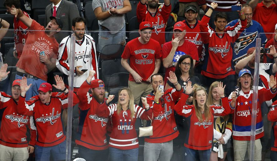 Washington Capitals fans celebrate after the Capitals defeated the Vegas Golden Knights in Game 5 of the NHL hockey Stanley Cup Finals Thursday, June 7, 2018, in Las Vegas. (AP Photo/Ross D. Franklin) **FILE**