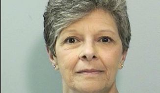 """This Sept. 21, 2012 inmate identification photo provided by the California Department of Corrections and Rehabilitation shows Susan Lee Russo. California Gov. Jerry Brown has denied parole for Russo, now 63, who prosecutors dubbed a """"black widow"""" because she had her husband killed. Brown on Friday, June 8, 2018 blocked her release a year after he commuted her life sentence, allowing her a chance at parole. (California Department of Corrections and Rehabilitation via AP)"""