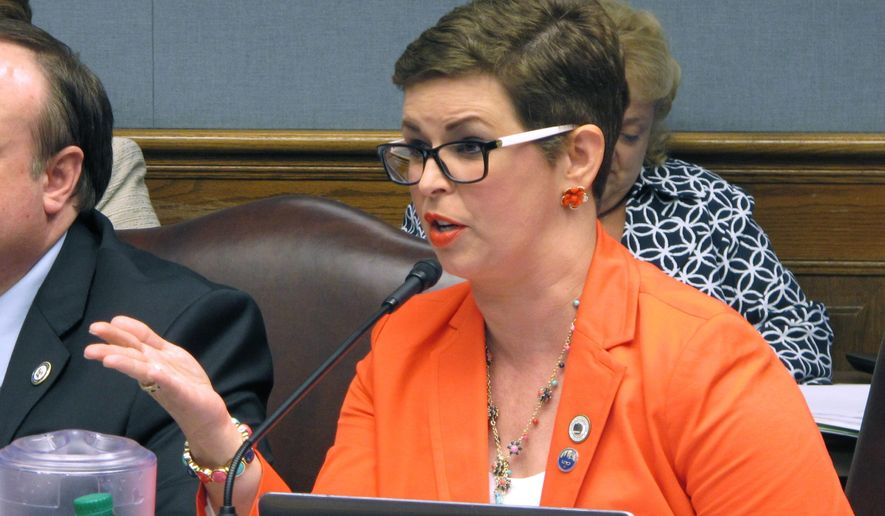 FILE - In this May 24, 2018 file photo, Rep. Julie Stokes, R-Kenner, right, speaks about taxes during a meeting of the House Ways and Means Committee in Baton Rouge, La. Stokes' bout with breast cancer has spurred her to change how the disease is treated in Louisiana. She says she wanted to get the word out about the different kinds of health care options available for those with breast cancer. So she introduced bills to require that insurers cover breast cancer screenings after a woman has a bilateral mastectomy and for health coverage plans to cover digital breast tomosynthesis, a procedure that creates a 3D image of a breast. (AP Photo/Melinda Deslatte, File)
