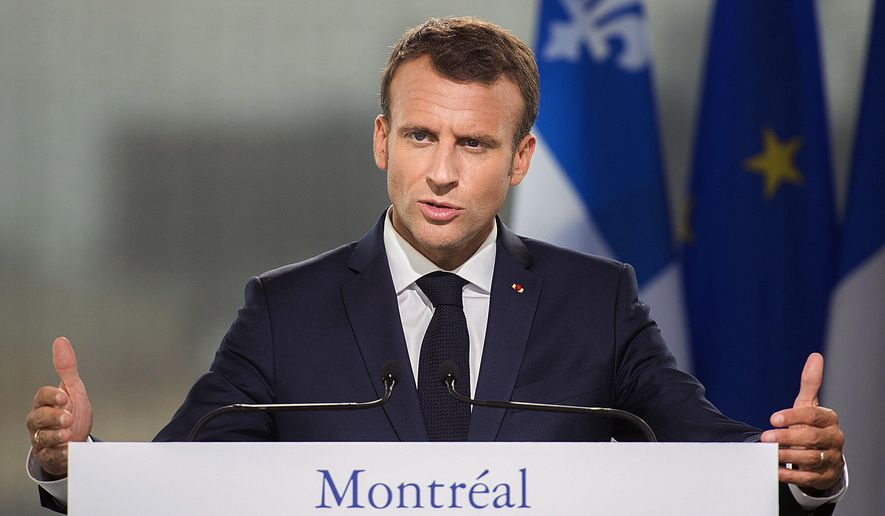 French President Emmanuel Macron speaks during a news conference in Montreal, Thursday, June 7, 2018. (Graham Hughes/The Canadian Press via AP)