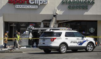 Authorities work at the scene where a pickup truck drove into a Starbucks parking lot and on to an outdoor patio, Friday June 8, 2018, at a Salt Lake City suburban shopping center in Millcreek, Utah. One person is dead and several others injured. (Trent Nelson/The Salt Lake Tribune via AP)