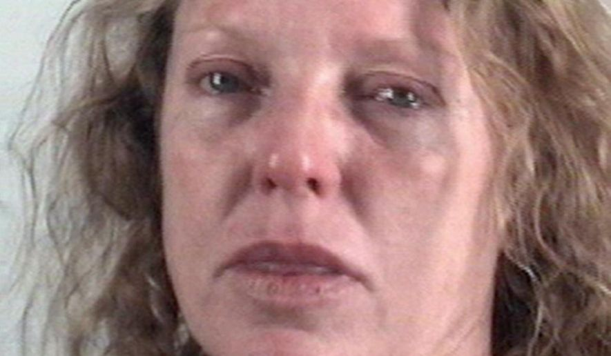 """This photo provided by the Tarrant County Sheriff's Office in Fort Worth, Texas, shows Tonya Couch,  who was booked into a Fort Worth jail Thursday, June 7, 2018, after a judge issued an arrest warrant accusing her violating the conditions of her bond. The warrant alleges that Couch tested positive for amphetamine or methamphetamine, violating the terms of her release on bond.  Couch is the mother of a Texas teenager who used an """"affluenza"""" defense in a fatal drunken-driving wreck.  (Tarrant County Sheriff's Office via AP)"""